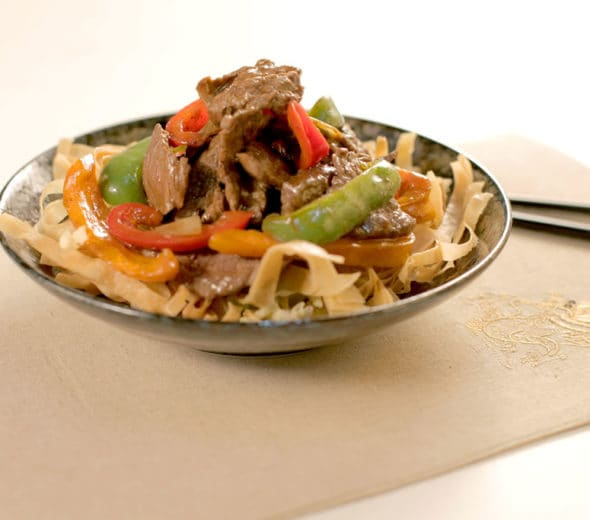 Juicy Black Pepper Steak Stir Fry on Crispy Spring Rolls
